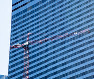 Reflection of crane in Chicago windows Royalty Free Stock Photography