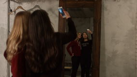 Reflection of cute girls taking selfie in mirror stock video footage