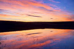 Reflection of dawn in the water stock photography