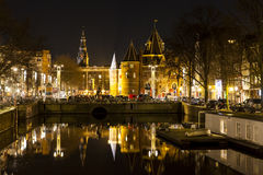 Reflection of De Waag on the Nieuwmarkt square in Amsterdam Stock Photography