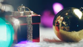 The concept of the start of the holiday. Reflection in the decorative Santa Claus Christmas ball. Santa Claus put a gift, waving. In Santa rejoices at the stock footage