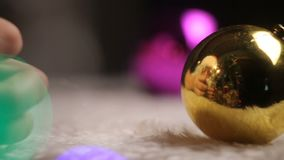 The concept of the start of the holiday. Reflection in the decorative Santa Claus Christmas ball. Santa Claus put a gift, waving. In Santa rejoices at the stock video footage