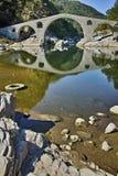 Reflection of Devil's Bridge in Arda river and Rhodopes mountain, Bulgaria Stock Photo