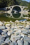 Reflection of The Devil's Bridge in Arda river and Rhodopes mountain, Bulgaria Stock Image