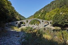 Reflection of The Devil's Bridge in Arda river and Rhodopes mountain, Bulgaria Stock Photo
