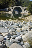 Reflection of Devil's Bridge and Rhodopes mountain in Arda river,  Bulgaria Stock Images