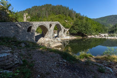 Reflection of Devil& x27;s Bridge in Arda river and Rhodopes mountain, Bulgaria Royalty Free Stock Photos