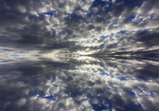 Reflection of dramatic clouds Stock Image