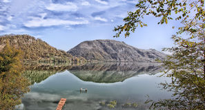 Reflection of the Drina River. The border between the two countries, Serbia and Bosnia and Herzegovina stock photo