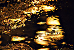 Reflection of the electric light in the rain Stock Photo