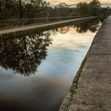 Sunset warms the Leeds and Liverpool Canal stock image