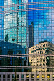 Reflection on the facade of a modern building of glass Stock Image