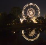 Reflection of fairground ride. In river in Stuttgart Stock Photo