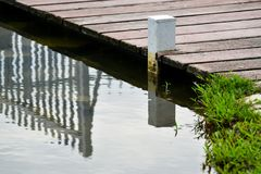 Wooden bridge reflection on lake royalty free stock photo