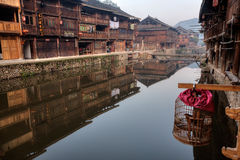 Reflection of farmhouses in water rural river, Zhaoxing, Guizhou Royalty Free Stock Image