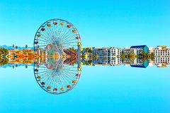 Reflection of the ferris wheel in the city Stock Photos