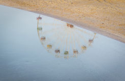 Reflection Ferris wheel in the water Royalty Free Stock Image