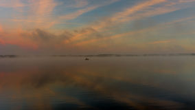 Reflection of the first rays of dawn sunlight in the lake. Royalty Free Stock Photography