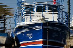 Reflection of a fish boat stock photography