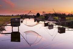 Reflection of fisheries on the river Royalty Free Stock Photography