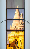 Reflection of Fisherman`s Bastion, aka Halaszbastya, fairy tale towers in modern hotel windows. Architectural contrast Stock Image