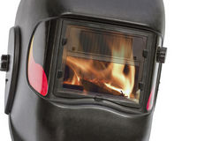 Reflection of the flame in the glass protective mask Royalty Free Stock Photography
