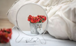 Reflection of flowers in the mirror Royalty Free Stock Photography