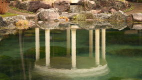 Reflection gazebo with pillars in the water.  stock footage