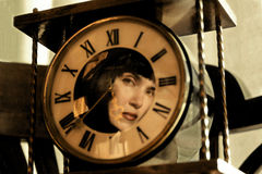 Reflection of the girl in the  clock. Reflection of the girl in the old clock Royalty Free Stock Photos