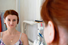 Reflection of the girl in the mirror in the bathroom. Reflection of the girl in the mirror in bathroom stock images