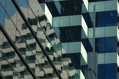 Reflection on glass building. High rise building or skyscraper reflected on glass windows Royalty Free Stock Photos