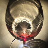 Reflection of a glass of red wine Stock Photos