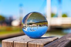 Reflection in the glass sphere outdoors Stock Photography