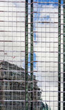 Reflection on glass windows of office buiding Stock Photography