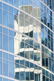 Reflection in glasses of a building royalty free stock photography