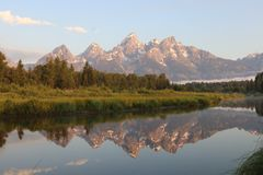 Morning reflection of the Grand Tetons stock photos