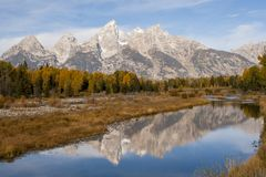Reflection of Grand Tetons in river stock photo
