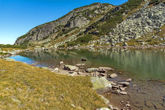 Reflection of green hills in small Lake, Rila Mountain Stock Image