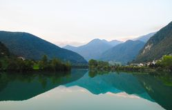 Reflection of green, nature background. Reflection of green, mountains and lake water,village and nature background Stock Photo