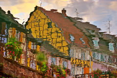 Reflection of Half-Timbered Street. In River Royalty Free Stock Image