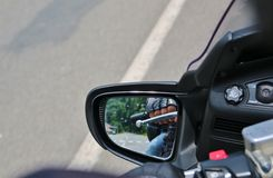 Reflection of Hand rider on the handlebars Stock Photos