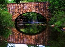 Reflection at Hidden Stone Bridge. Stone Bridge at Petit Jean, deep in the heart of the Ozarks stock images