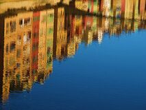 Reflection of High Rise Buildings of Calm Body of Water during Daytime Royalty Free Stock Image