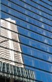 Reflection of high-rise corporate office building with blue sky Royalty Free Stock Photos
