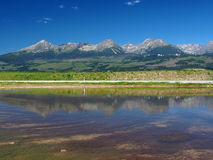 Reflection of High Tatras in lake stock photography
