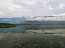 Dal lake of Sri Nagar. The reflection of the hills on the water of Dal lake in Sri Nagar, Kashmir during an evening walk stock photos