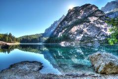 Reflection of hillside in lake