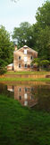 Reflection of historic bakery. Reflection of historic brick bakery in foreground pond Stock Images