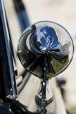 Reflection on Historical usa sportive vehicle. Reflection on a mirror of historical usa sportive vehicle Royalty Free Stock Photos