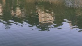 Reflection of home from river cruise ship on Rhône River in France. Abstract reflection of home from river cruise ship on Rhône River in France Stock Image